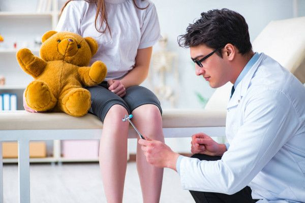 depositphotos_214139456-stock-photo-doctor-checking-up-young-girls